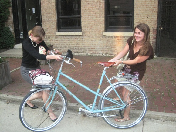 two women, one bike