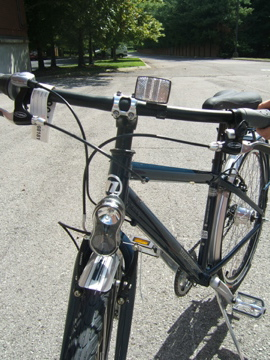 Front dynamo headlight and reflector