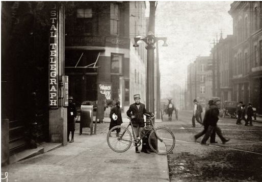 """Original caption: """"George Christopher, Postal Telegraph messenger #7, fourteen years old. Been at it over three years. Does not work nights."""""""