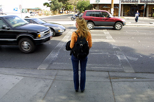 Student Waiting to Cross Street - PBIC Image Library